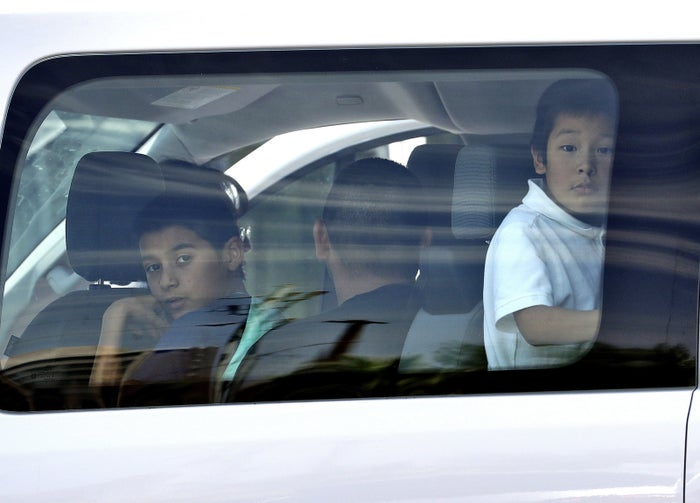 Immigrant children arrive at Lutheran Social Services on July 26 in Phoenix.