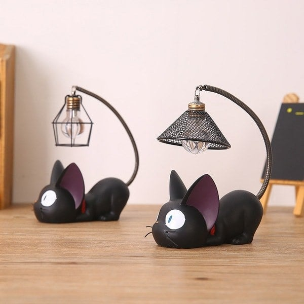"""Promising review: """"This mini black cat light is really great. It appears to be quite durable and is absolutely adorable. The light is surprisingly bright and ideal as a small nightlight, reading light (if kept close), or just a little highlight in your room. It is another must for every Kiki's Delivery Service/Jiji fan!"""" —ni****@rocketmail.comGet it from Apollo Box for $18.99 (available in two styles)."""