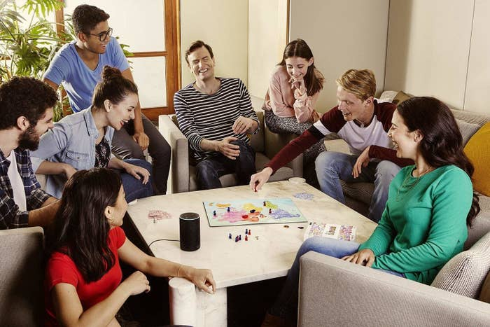 Group of people having a fun time playing When in Rome in a living room space