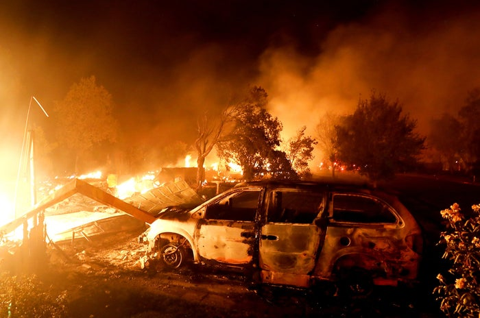 A home burns along Sunflower Road in Redding, California.