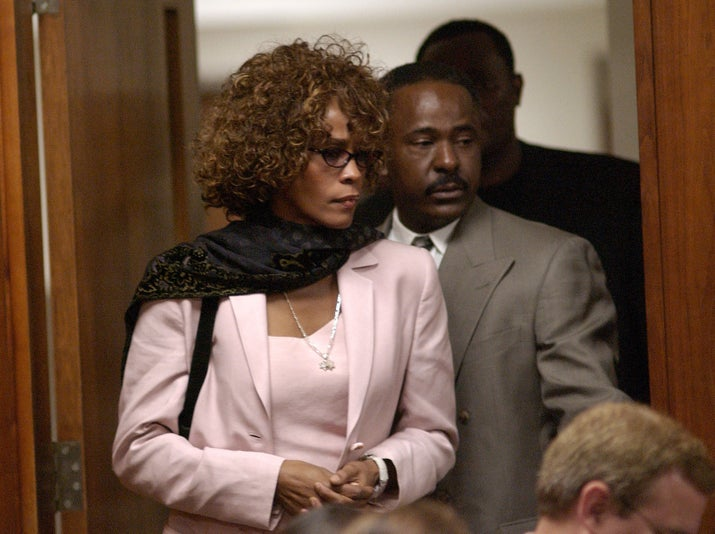 Houston enters the courtroom for Brown's probation violation hearing on Aug. 27, 2003.