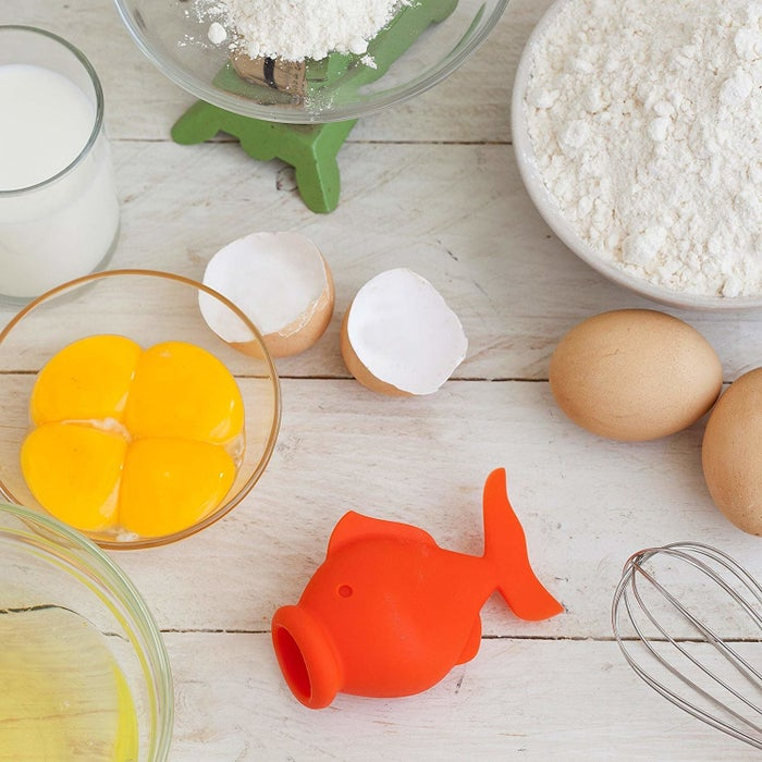 """Promising review: """"Love this idea. It's fast, simple, and easy to use and clean. I have no trouble using it with large eggs. I think the trick is to just be gentle and not forceful. This is definitely better than the wire holder I have been using!"""" —meisslerGet it from Amazon for $12.96+ (available in three adorable animals)."""