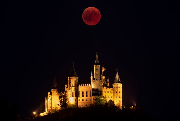 A blood moon rises behind Hohenzollern Castle in Hechingen, Germany.