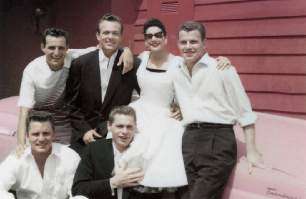 Scotty Bowers (second from left in top row) with friends