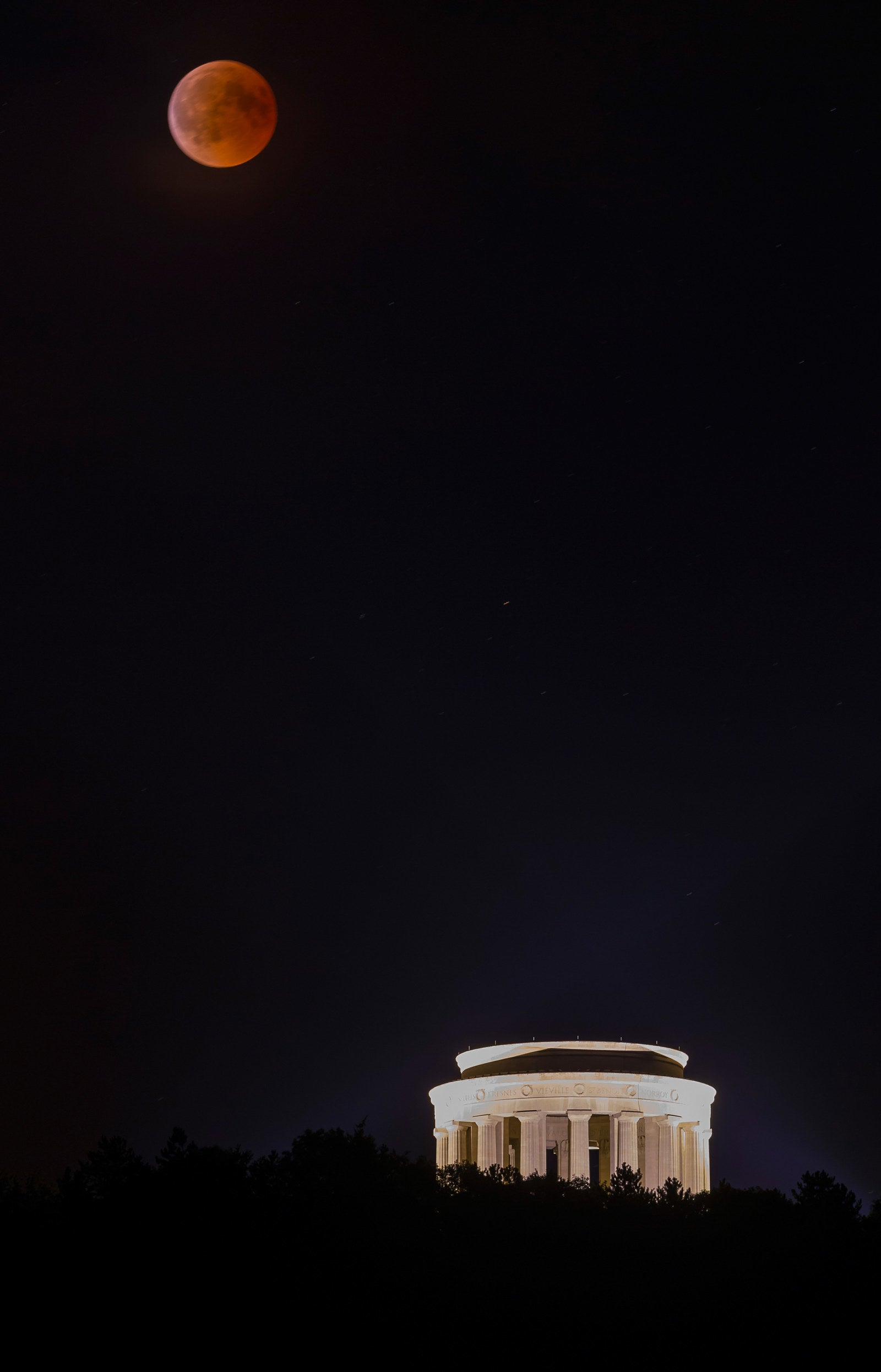A blood moon seen over the American Memorial of the Montsec hill in Montsec, France.