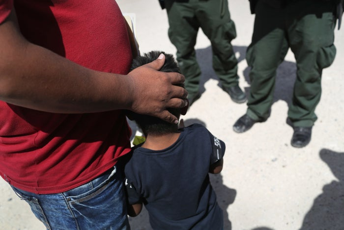 Border Patrol agents taking a father and son from Honduras into custody near the US–Mexico border on June 12.