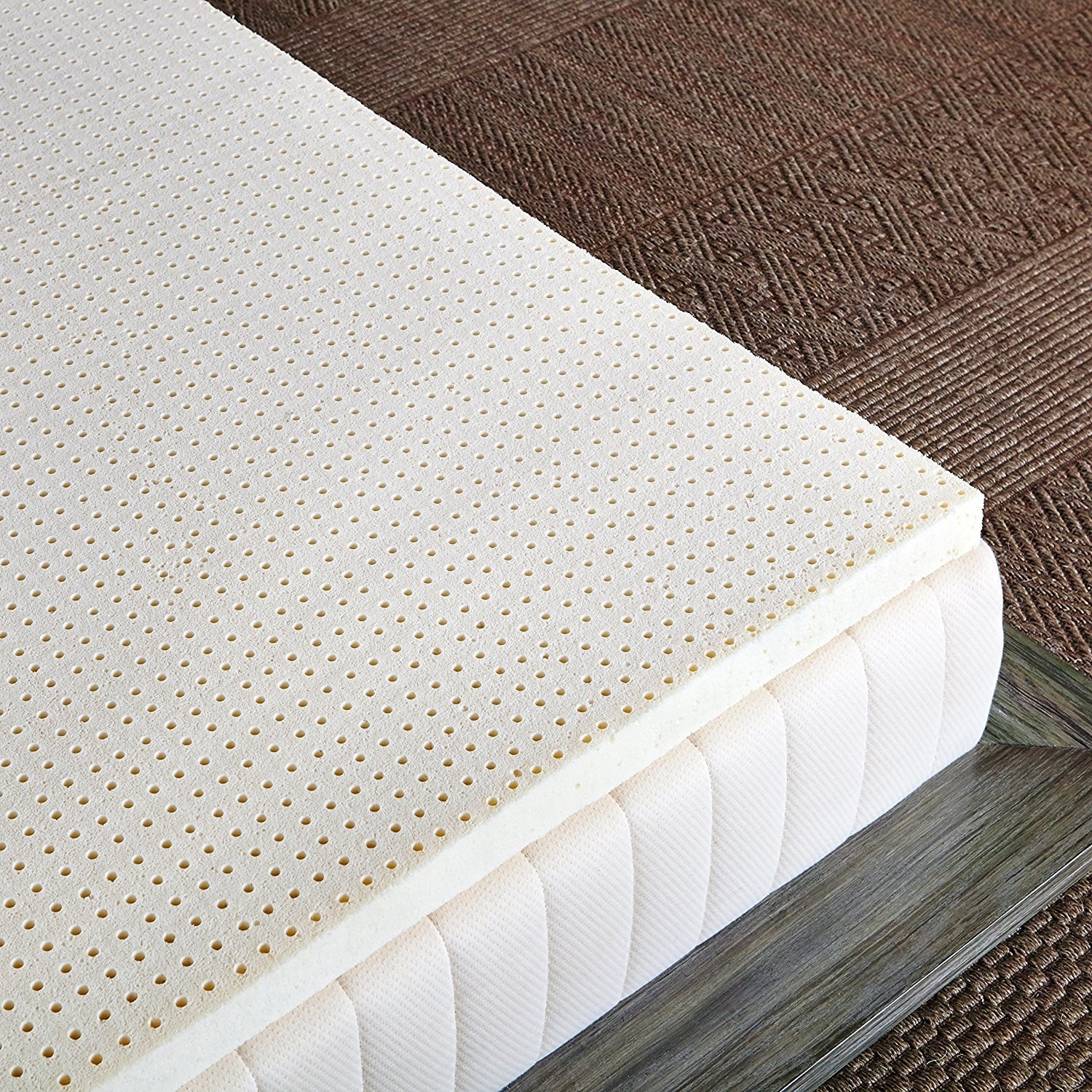 The topper on a mattress — it's dotted with a small grid of holes for airflow