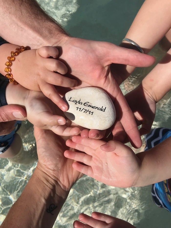 Youngman and his family about to place a stone in remembrance of Layla.