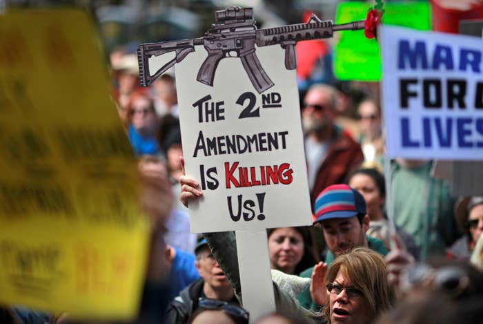 Protesters hold signs during a March for Our Lives demonstration demanding gun control in Sacramento, California.