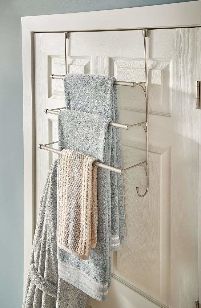 """This one's elegant, and has two functional hooks at the bottom corners for your robe or dirty clothes. Promising review: """"This towel holder does the job. After using it for a few days towels actually dry completely with no odor with out being totally extended. Easy to put together although it comes with very small screws."""" —SirGOGet it on Amazon for $16.68 (also available in bronze)."""