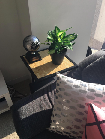 black end table with wooden surface