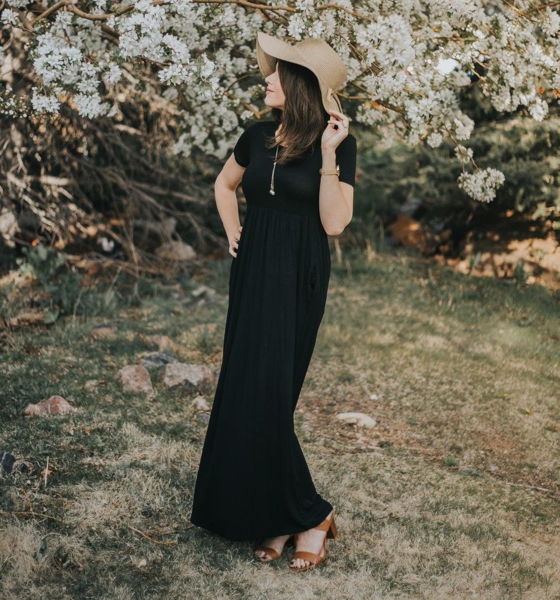 Reviewer wearing black maxi dress