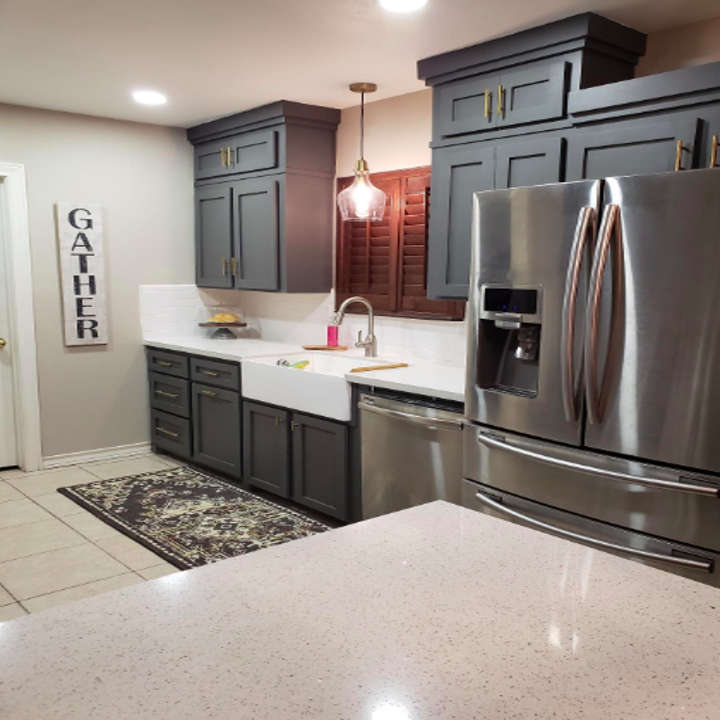 Reviewer image of kitchen upgraded with the knobs