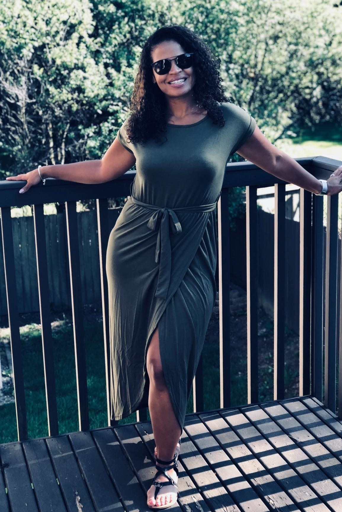 Reviewer wearing olive colored dress