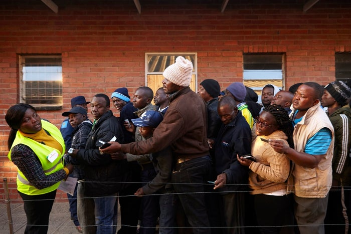 People line up early in the morning at a polling station in Chitungwiza during Zimbabwe's 2018 general elections to elect the president and members of Parliament.