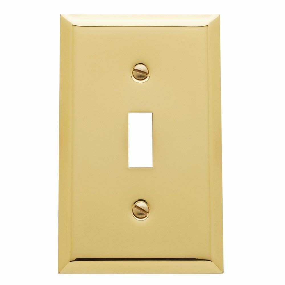 A brass light switch