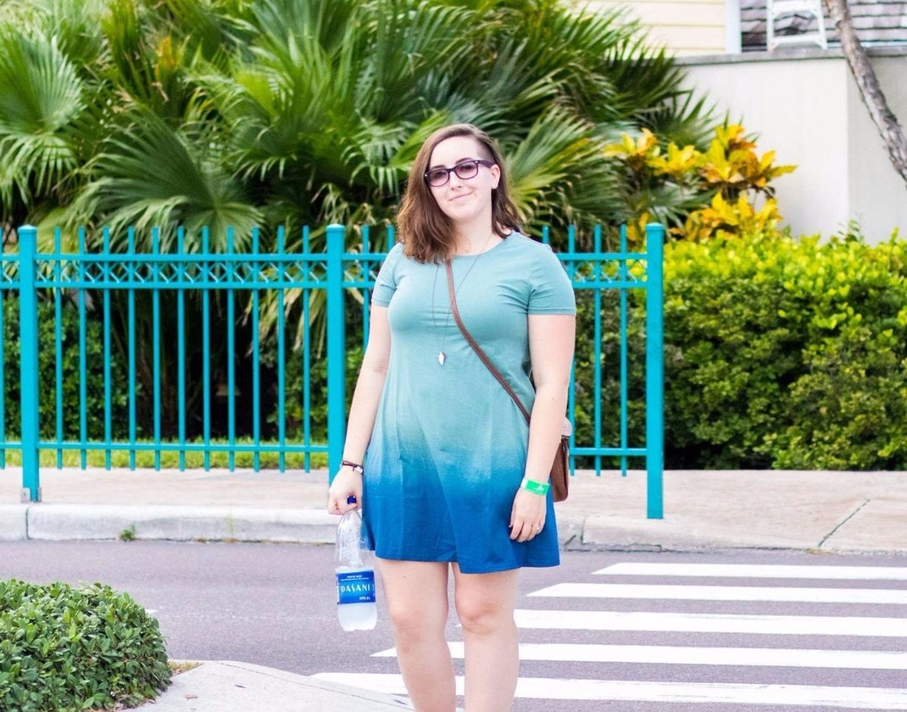 Reviewer wearing blue and mint tie dye dress