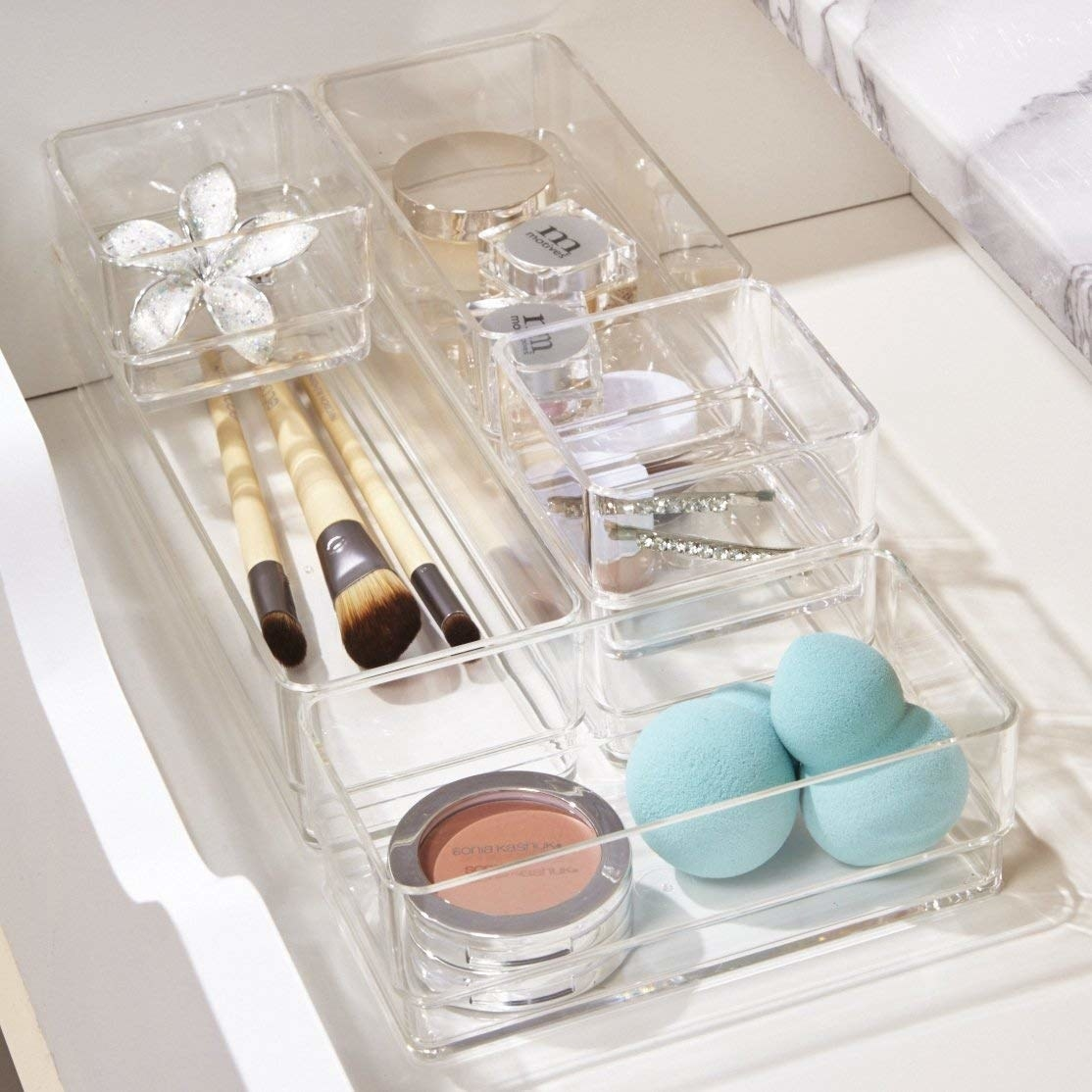 """Promising review: """"This set is exactly what I've been looking for. They fit perfectly in my drawers, and stacked they are the exact depth of the shallow drawer in my vanity. Perfect for organizing all the small tools and bits of makeup, bottles of perfume and tubes of medicine etc. Appear to be heavy/high quality enough to last a long time."""" —S. KnoxGet the set on Amazon for $14.99."""