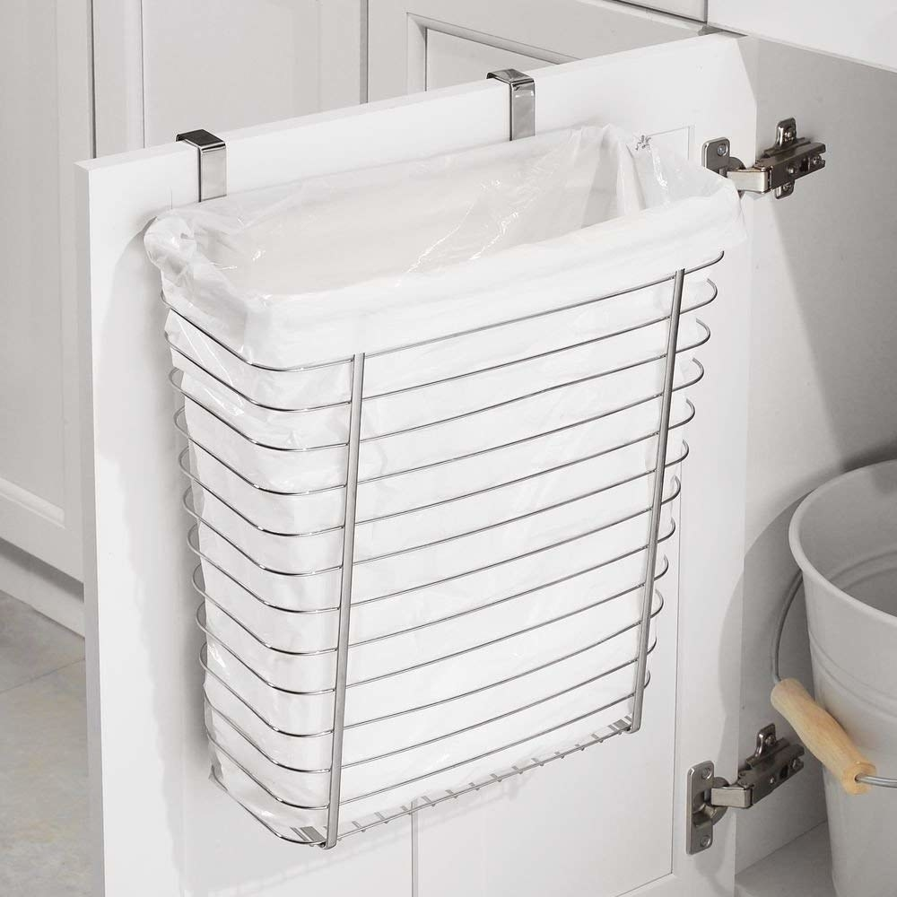 """Skip the trash bag and it becomes a deep storage basket, instead! Promising review: """"Fits well under the bathroom sink. My Bassett kept getting into the bathroom garbage (a small stainless step can), so I got this to keep him out of the trash and save storage space in the vanity. Only complaint is I added Command Strips where the base touches the door so it doesn't clang when I open it."""" —Lauren W.Get it on Amazon for $11.89."""