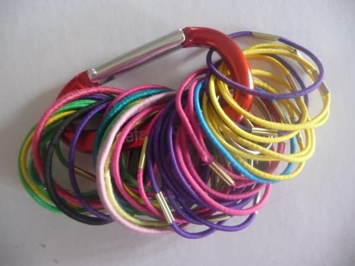 Or put them on multiple carabiners, and have a few with you wherever you go! From Hi, It's Jilly. Get a set of 10 colorful carabiners on Amazon for $10.99, and give one to all of your friends so they can organize their hair ties, too.