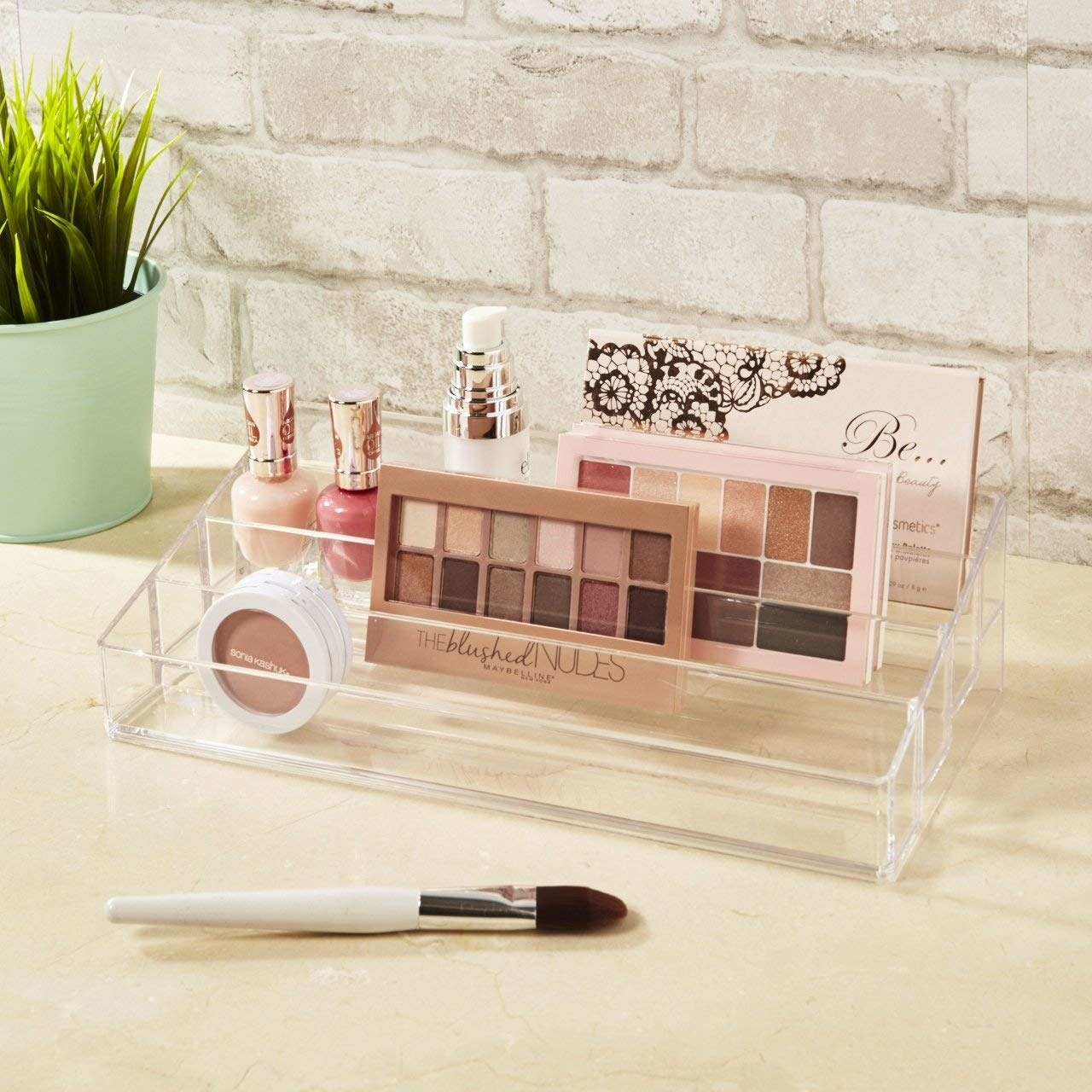"""It's 12 inches long (by six inches wide), so it can fit more products than you expect. It could work no matter how much makeup you have: if you're a minimalist, it can hold just the few products you use most; if you have every palette under the sun, you may want more than one! Promising review: """"I was looking for something that would fit my Morphe palettes upright, not on their sides. This works perfectly! It fits thick palettes like the Tarteist contour palette, medium-thick palettes like the Morphe blush palettes and the Coastal Scents hot pot palette, and thin palettes like Lorac Mega Pros. If you have a lot of makeup, I wouldn't hesitate to buy this. I'm sure it will fit anything you have. This organizer is just what I was looking for, and at the right price!"""" —eXampleGet it on Amazon for $12.99."""