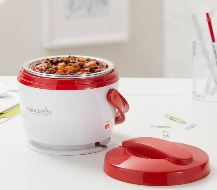 """It has a 20-ounce capacity. The removable vessel and lid are dishwasher-safe.Promising review: """"A friend recommended this little Crock-Pot and uses it at work, she loves it and is always talking about it. I used mine today for the first time — had it on my desk at work — and it was sooo handy. Had chicken casserole and it was so nice to reach over and have a nice hot lunch at my fingertips. I eat a lot at my desk and work through lunch. Wish it had an on and off switch but just need to remember to unplug it after lunch. I asked a co-worker if she could smell my lunch heating up (don't want to bother others around me) but she could not. The screw-on top seems to keep the food smell contained (but maybe it was what I was eating). Love it and so glad I bought it, will use it regularly."""" —camurphGet it from Walmart for $19.94 (also available in green)."""
