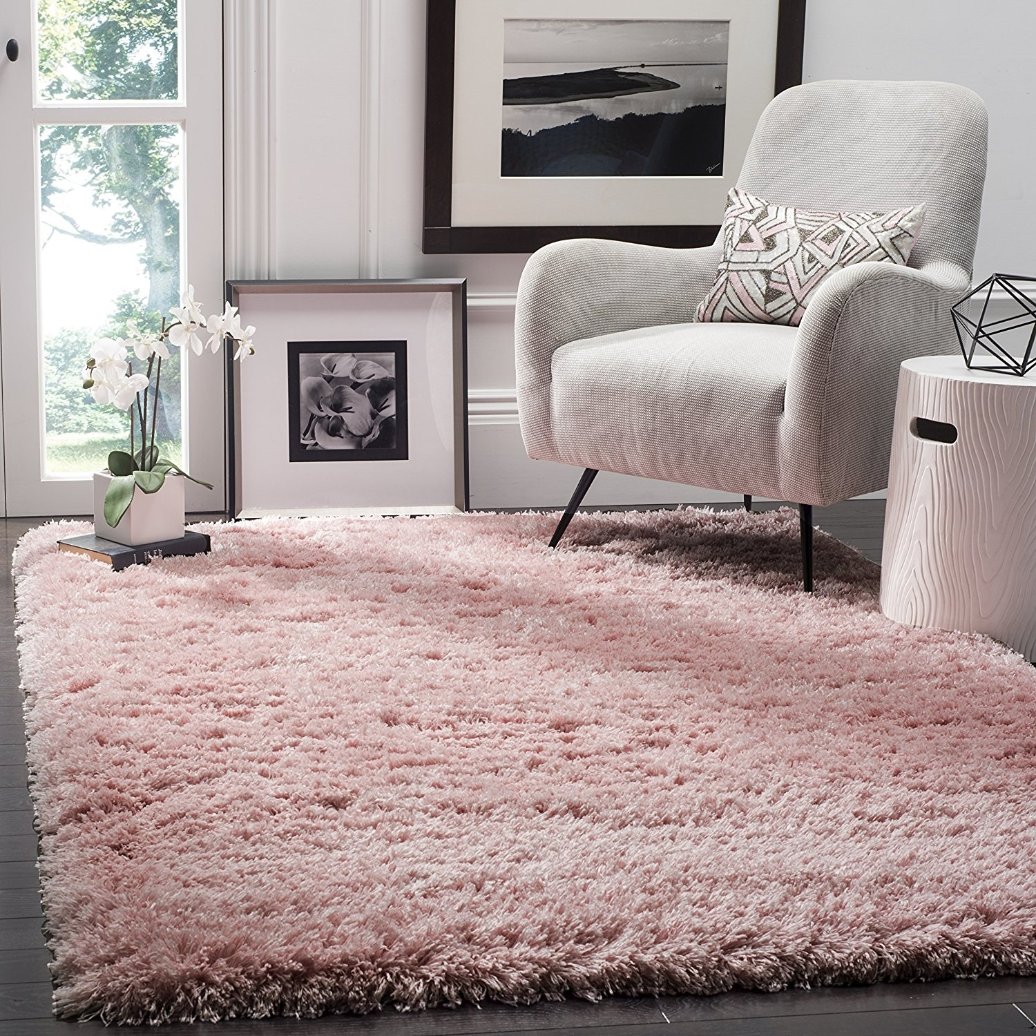 a large light pink faux shag rug that covers an entire room