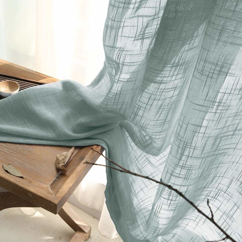 The cross-hatch textured curtains in a light teal