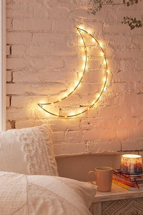 A crescent moon-shaped wall light