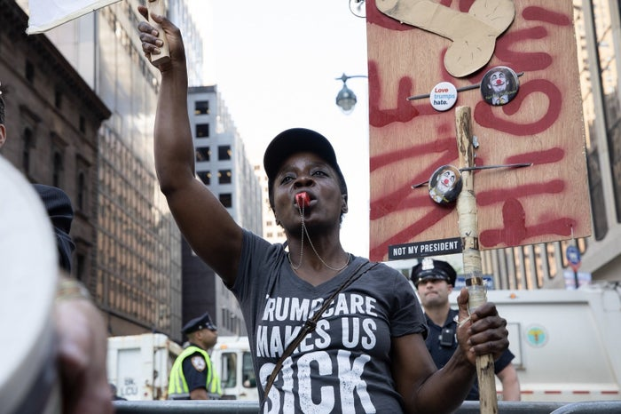 In a photo from a May protest against President Donald Trump in New York City that Okoumou shared to her Facebook page, she can be seen in a shirt similar the one she was wearing Wednesday.