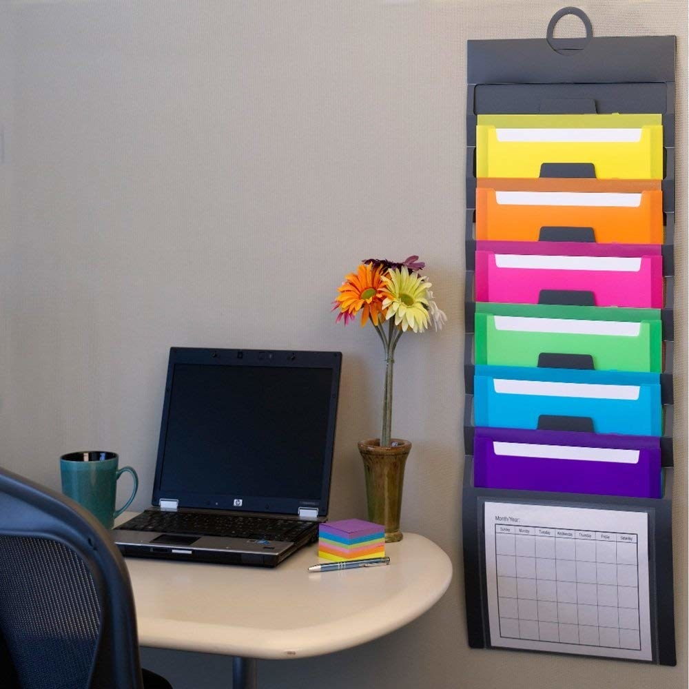 The organizer with colorful pockets hanging from a wall
