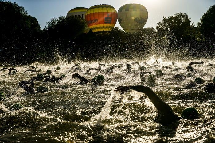 Athletes compete during the swim leg at the DATEV Challenge Roth 2018 in Germany.