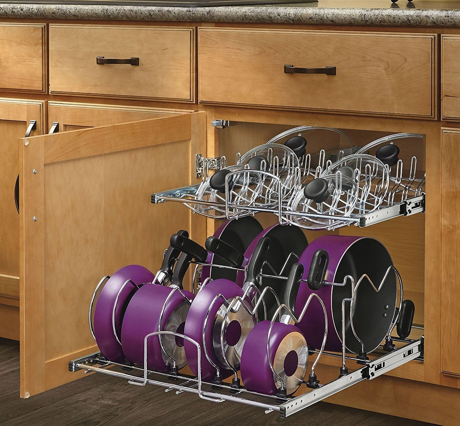 The metal organizer with seven pots/pans on the bottom and lids on top