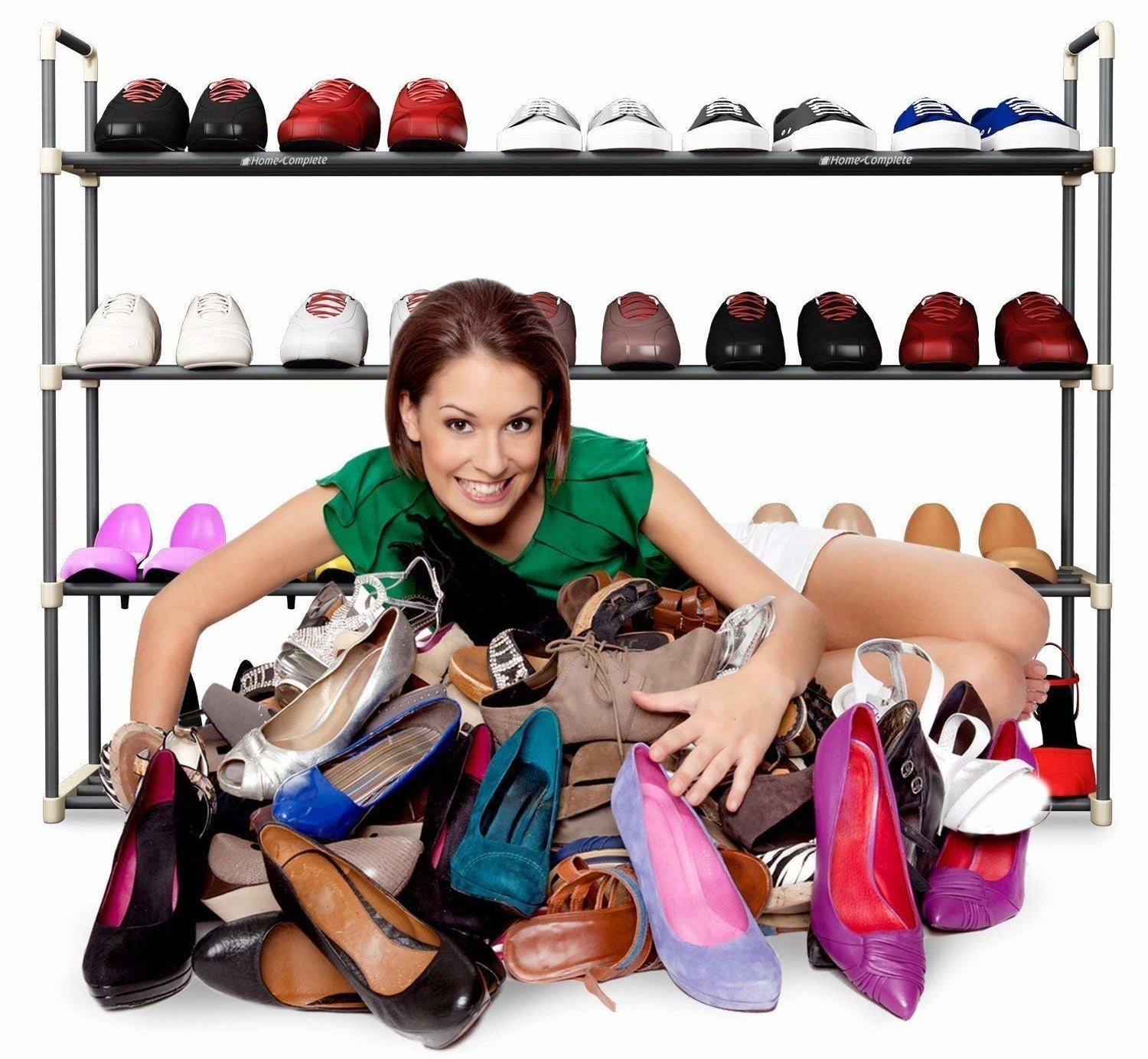A woman clutching shoes and smiling, with the four-tier rack with shoes behind her