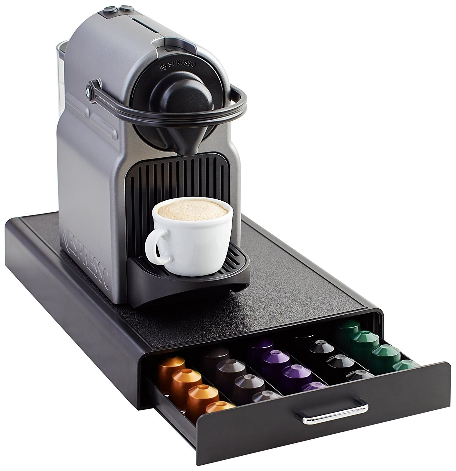 The drawer with capsules inside, with a Nespresso machine sitting on top