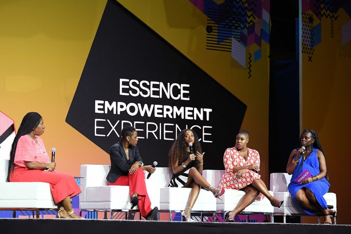 Tarana Burke, Luvvie Ajayi, Tamika Mallory, Symone Sanders, and Yolanda Sangweni speak onstage Friday during the 2018 Essence Festival.