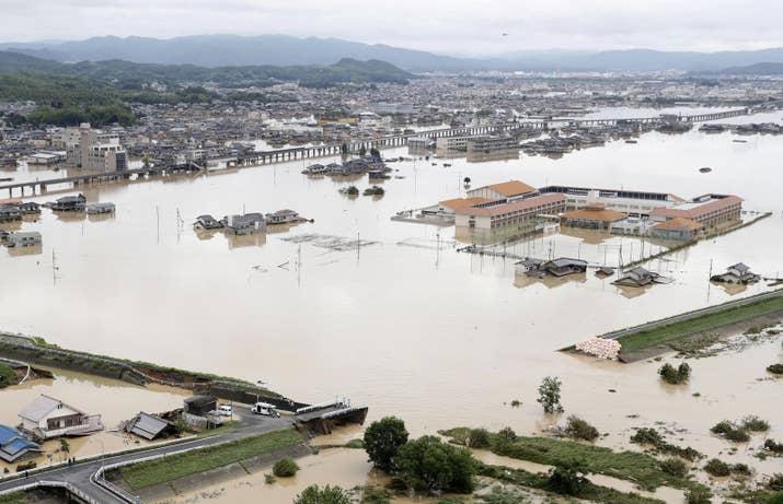 A broken riverbank is seen after heavy rain in Kurashiki, Okayama prefecture.