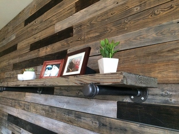 """I used our old fence to make an accent wall for our bedroom. I even built the floating shelf!"" —sueb41bbed5cd"