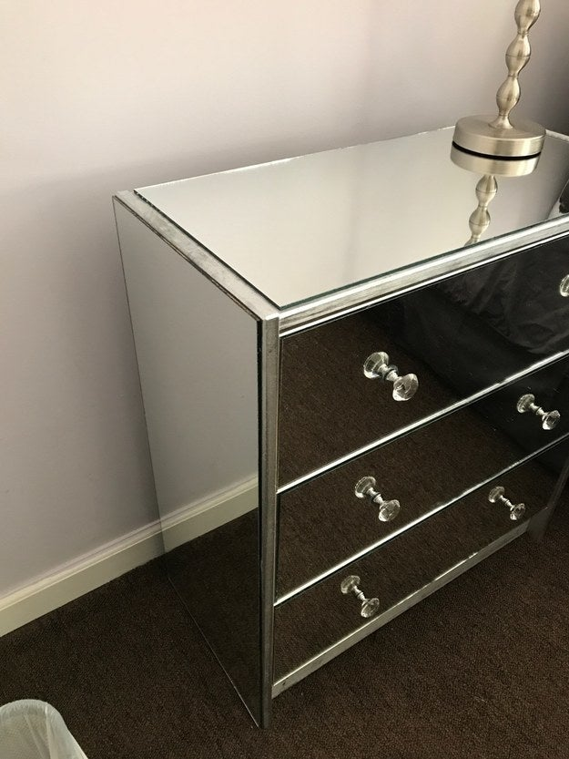 """After spray-painting an Ikea dresser silver, I glued on mirrors that I had cut at Lowes, and glued door knobs from Hobby Lobby to the mirrors. The entire project cost $76!"" —ashleyt4f6a2264d"