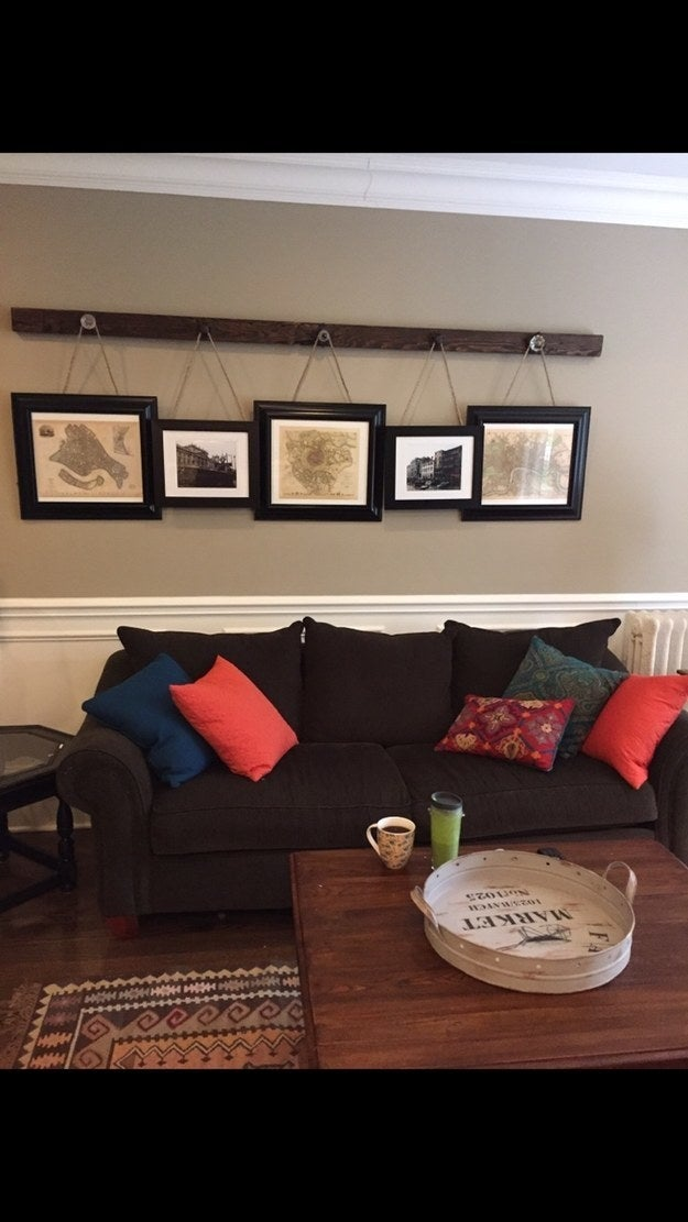 """I attached door knobs I found at Hobby Lobby to a wood beam. I stuck braided twine to the art and hung them from the knobs. The whole thing was so heavy, I needed a special bracket to hang it. It's my favorite part of my apartment!"" —amandai4357b7eb4"