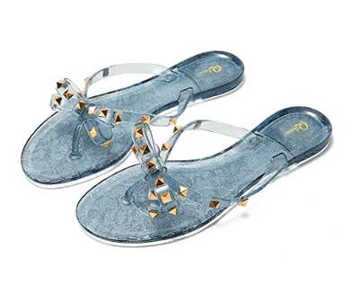 06c7ee4aec75 Precious summer jellies featuring a bow sure to grab everyone s attention  as you gallivant in the heat like a champion.