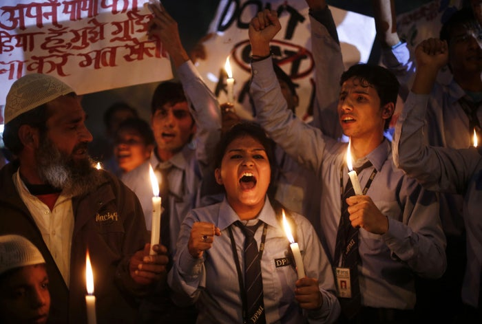 Students in New Delhi take part in a vigil to mark the first anniversary of the victim's death.