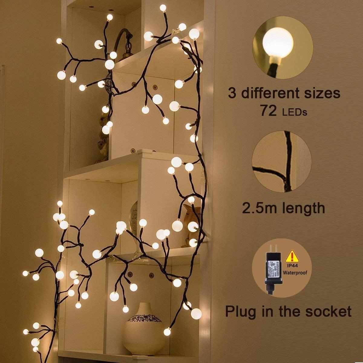 The lights trailing along a wall shelf