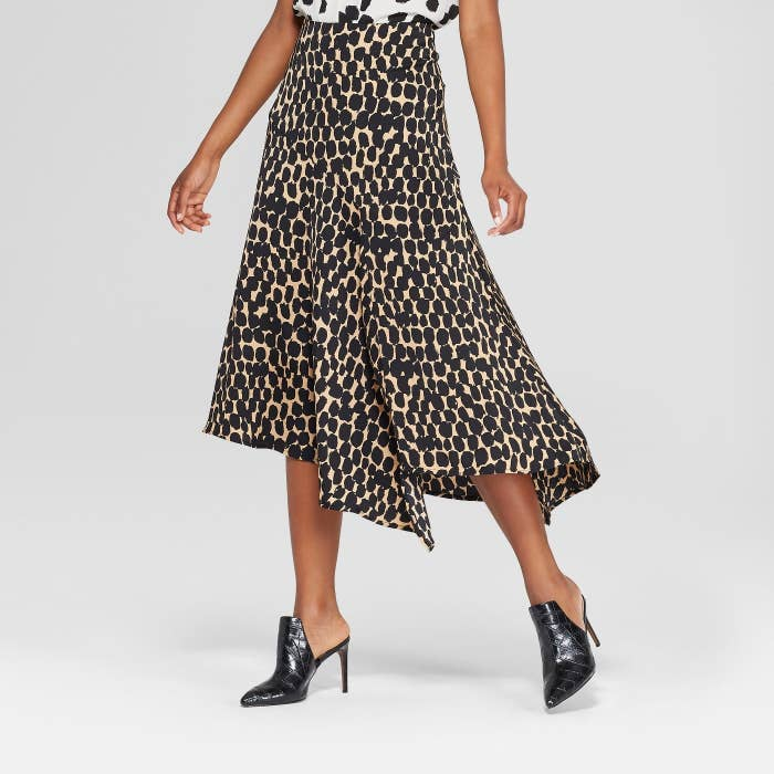 98447d9c69125 A fabulous asymmetrical slip skirt in a classic leopard print (it also  comes in a gorgeous spice color that is just !!!) you can pair with white  sneakers ...
