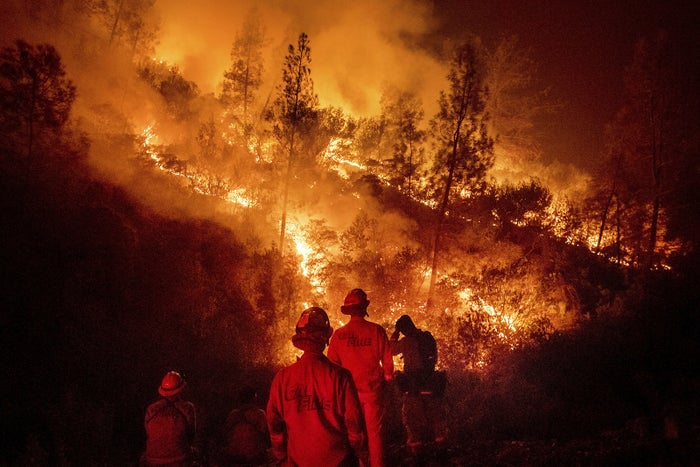 Firefighters monitor a backfire while battling the Ranch fire near Lodoga, California, on Aug. 7.