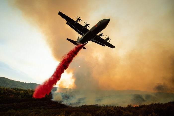 An air tanker drops retardant on the Ranch fire, part of the Mendocino Complex fire, burning along High Valley Road near Clearlake Oaks, California, on Aug. 5.
