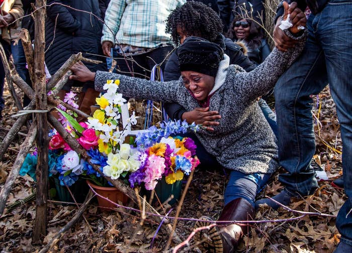 Fatmata Corneh visits a memorial constructed for her daughter, Mujey Dumbuya, in the woods where her body was found in Kalamazoo, Michigan.
