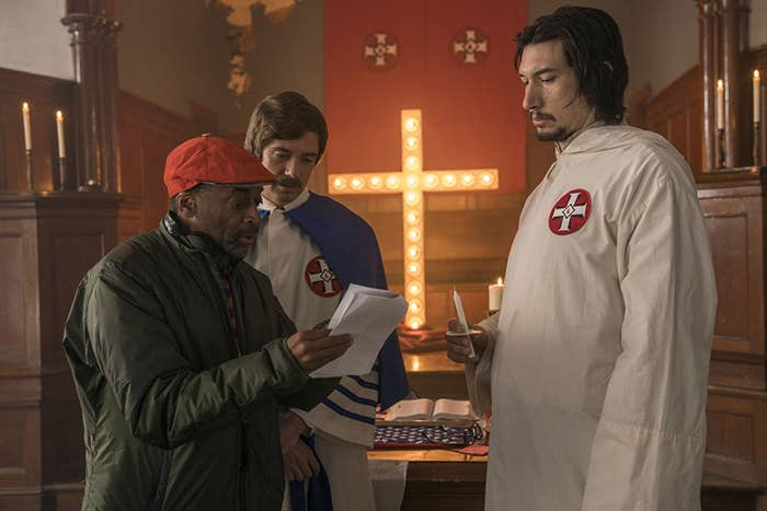 Director Spike Lee with Topher Grace and Driver on the set of BlacKkKlansman.