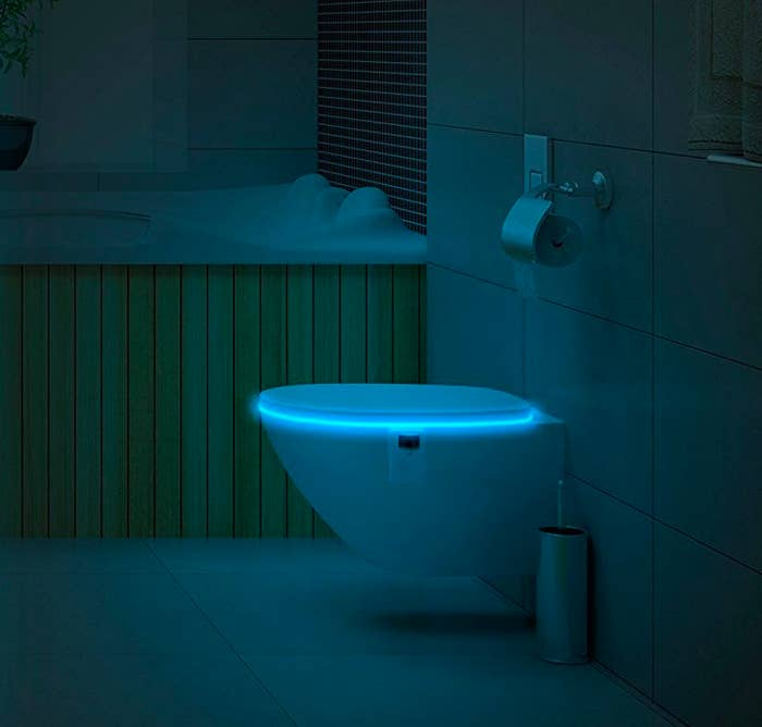 """The flexible design makes it possible to fit this light into any toilet bowl. And this thing has a lifetime guarantee! Promising review: """"I've had this device for a little while now and I absolutely love it! The light detector and motion detector work together to only turn the toilet light on when it senses darkness and movement. I love that there are 16 different colors you can choose from, and you can raise or lower the brightness of each color. I ended up getting two of these toilet lights for both of my bathrooms and my guests love it. I give the product five stars for its low price and for the control/options it gives me."""" —Sergio RiosGet it from Amazon for $14.95."""