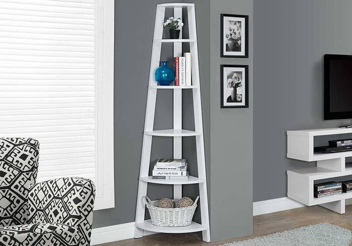 And A Six Tier Corner Bookshelf Youd Better Add To Your Cart Now Lest You Spend Another Second Tiered Apart Without This Beaut In Living Room